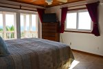 Master bedroom on the ground floor opens onto the main deck and enjoys the same stunning sea views.